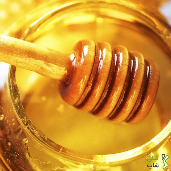قاشق چوبی عسل بسیار زیبا
