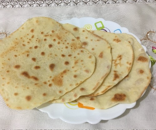 طرز تهیه نان خانگی بر روی تابه سفالی